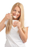 Young beautiful woman eating yogurt Royalty Free Stock Image