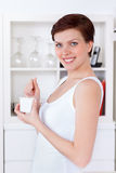Beautiful woman eating yogurt as breakfast or snack Royalty Free Stock Photo