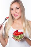 Young beautiful woman eats vegetable salad. Healthy eating. To be in shape. Royalty Free Stock Photo