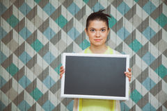 Young beautiful woman with emty chalkboard. Young beautiful women with emty chalkboard. Blank blackboard. Copy space Stock Photo
