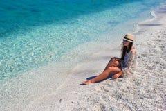 Young beautiful woman enjoying beach tropical Stock Photos
