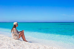 Young beautiful woman enjoying beach tropical vacation. Young beautiful woman enjoying the holiday on white tropical beach Stock Images