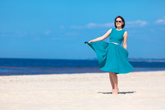 Young beautiful woman enjoying beach vacation Royalty Free Stock Photos