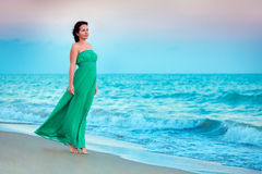 Young beautiful woman enjoying beach vacation Stock Photo
