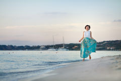 Young beautiful woman enjoying beach vacation. Sardegna, Italy Stock Photography