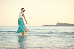 Young beautiful woman enjoying beach vacation. Sardegna, Italy Royalty Free Stock Photo
