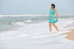 Young beautiful woman enjoying beach vacation Royalty Free Stock Images