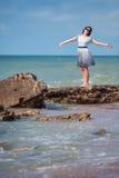 Young beautiful woman enjoying beach vacation Royalty Free Stock Images
