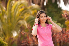 Young beautiful woman enjoying with headphones outdoors Royalty Free Stock Images