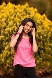 Young beautiful woman enjoying with headphones outdoors Royalty Free Stock Photos