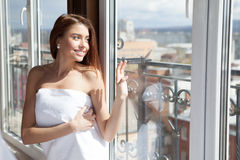 Young beautiful woman enjoying her morning near big window Stock Image