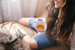 Young beautiful woman enjoying her morning tea royalty free stock image
