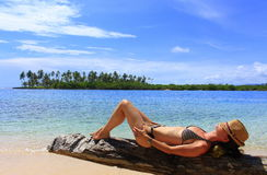 Young beautiful woman enjoying her time and resting close to the sea royalty free stock photos