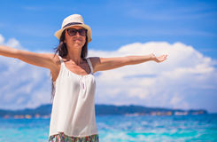 Young beautiful woman enjoying the holiday on Royalty Free Stock Images
