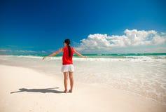 Young beautiful woman enjoying holiday on the Stock Image
