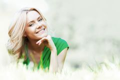 Woman on grass Royalty Free Stock Photo