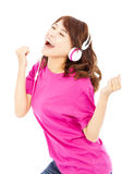 Young beautiful woman enjoying the music and dancing Stock Images