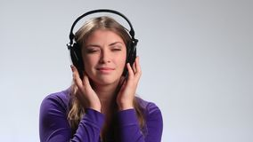 Young beautiful woman enjoying music in earphones stock video footage