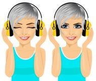 Young beautiful woman enjoying the music with headphones Stock Photo