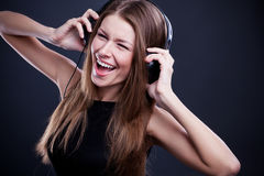 Young beautiful woman enjoying the music on headphones Stock Images