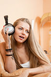 Young beautiful woman enjoying the music at home Royalty Free Stock Image