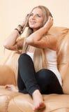Young beautiful woman enjoying the music at home Royalty Free Stock Photos