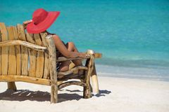Young beautiful woman enjoying summer vacation, beach relax, sum. Mer in tropics Stock Images