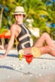 Young beautiful woman enjoying summer vacations on tropical beac Stock Photos