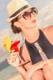 Young beautiful woman enjoying summer vacations on tropical beac Stock Photography