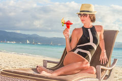 Young beautiful woman enjoying summer vacations on tropical beac Royalty Free Stock Image