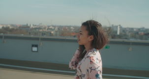 Young beautiful woman enjoying time on a rooftop. stock video