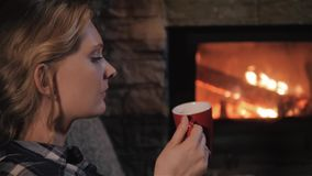 Young Beautiful Woman Enjoying Winter Hot Drink Relax By Fireplace At Home, Close Up Shot stock video
