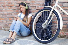 Young beautiful woman enjoys music with headphones Royalty Free Stock Photography