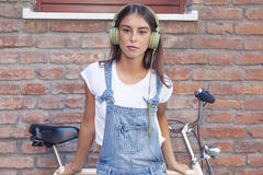 Young beautiful woman enjoys music with headphones Stock Photography