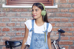 Young beautiful woman enjoys music with headphones Stock Photo