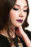 Young beautiful woman with evening makeup Stock Image