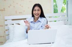 Young beautiful woman excited working laptop finish, sitting on Royalty Free Stock Image