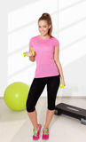 Young beautiful woman exercising with dumbells Royalty Free Stock Images