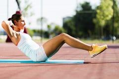 Young beautiful woman exercising outdoors Stock Image