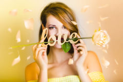 Young beautiful woman expressing feelings of love Royalty Free Stock Image