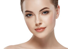 Young beautiful woman face close-up beauty portrait with healthy nature skin and perfect make-up Stock Photos