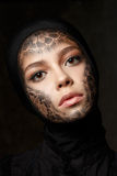 Young beautiful woman with faceart Stock Photos