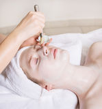 Young beautiful woman with facial mask, spa treatment Royalty Free Stock Image