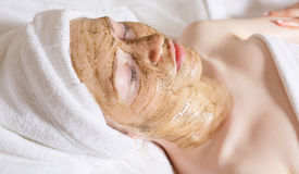 Young beautiful woman with facial mask, spa treatment Royalty Free Stock Images