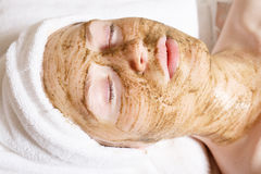 Young beautiful woman with facial mask, spa treatment Stock Photos