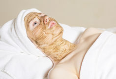 Young beautiful woman with facial mask, spa treatment Stock Photography