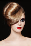 Hairdo. Young beautiful woman with fancy hairdo and smoky eyes stock images