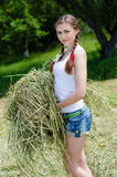 Young beautiful woman on farm in summer day Stock Images