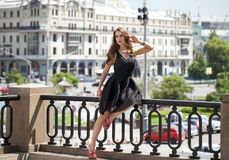 Young beautiful woman in fashion black dress Royalty Free Stock Images