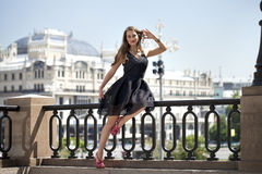 Young beautiful woman in fashion black dress Royalty Free Stock Photography